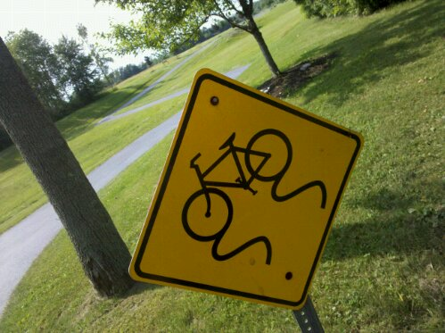 watch out for skidding bicycles, sign along a bike path